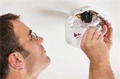 Man Installing Smoke Alarm Battery