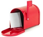 A red mailbox with an envelope inside