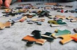 Photo of puzzle pieces on a table