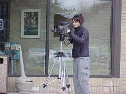 A camera operator uses the cable camera.