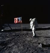Photo of astronaut and American flag on the moon
