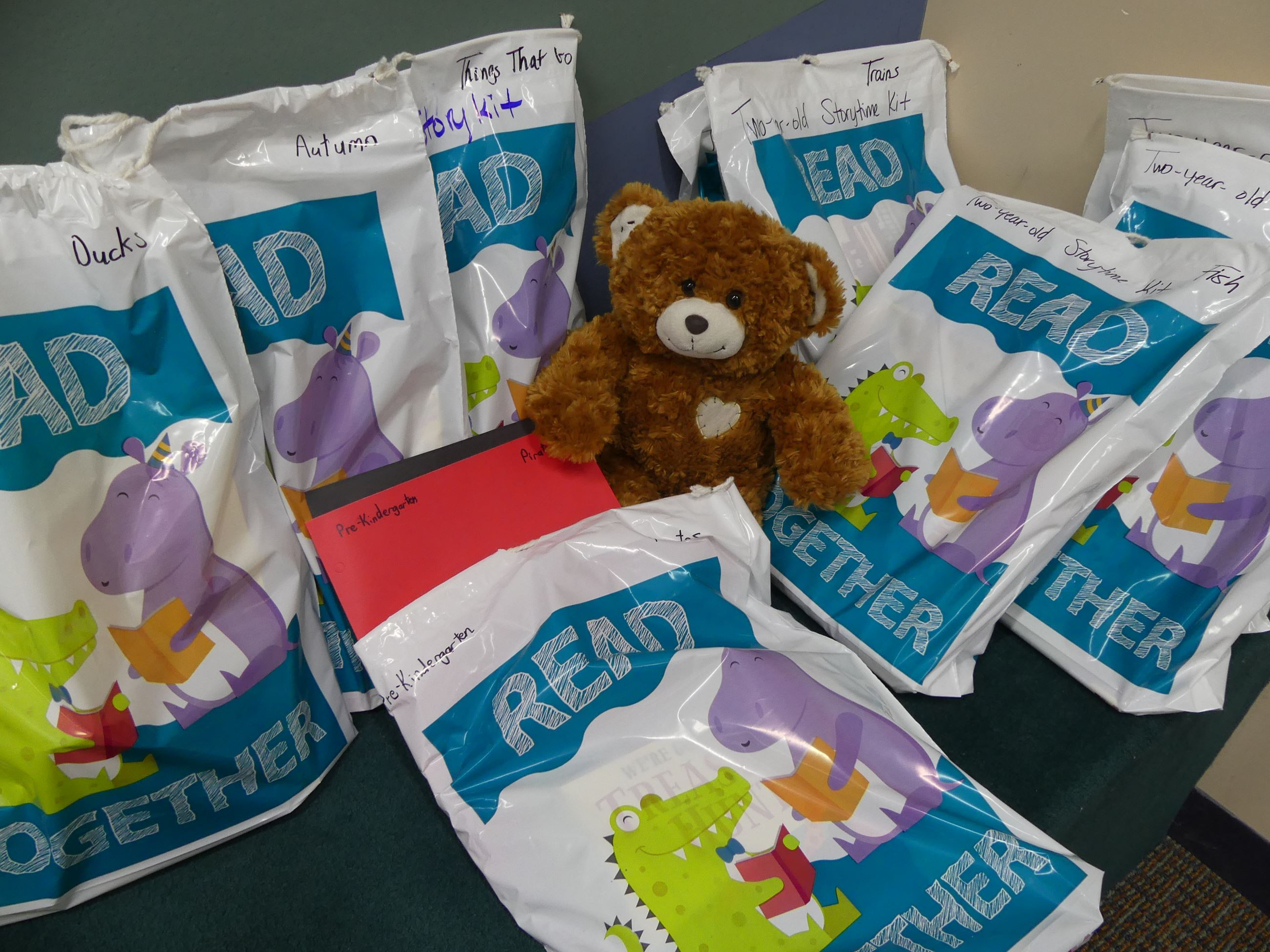 Teddy bear prepping story bags
