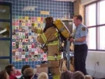 Fireman and Teacher Demonstrating