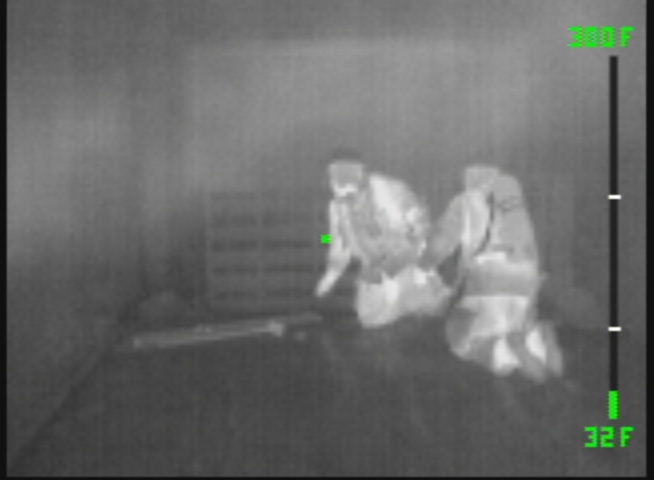 Thermal image of fire fighters in a dense smoke-fi