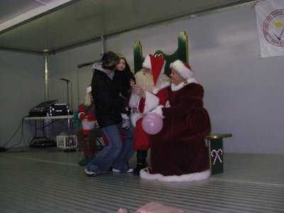 A girl on Santa's lap