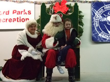 A little girl sitting on Santa's lap