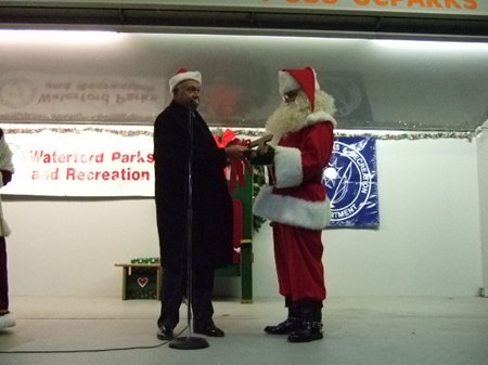 A man shaking hands with Santa