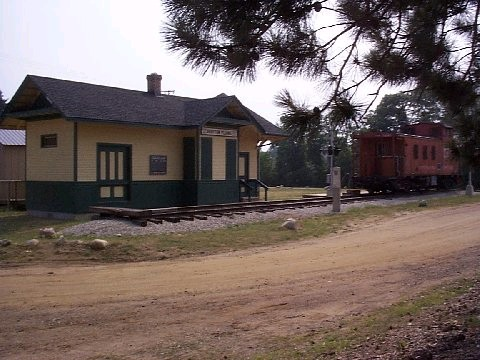 A train caboose and train depot